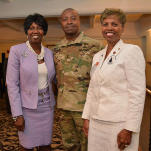 (From left) Dianne Crawford and Maj. Gen. Bruce T. Crawford, APG senior commander, pause for a photo with Janice Chance, president of the Maryland chapter of the American Gold Star Mothers, during the Surviving Families Luncheon at APG, March 9, 2016. (Courtesy photo)