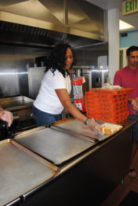Tyce Rucks, a contract specialist with the Army Contracting Command – APG, preps for making sandwiches while volunteering at the Welcome One Homeless Shelter in Belcamp, Maryland in August 2016. // U.S. Army photo by Betsy Kozak-Howard, Army Contracting Command - APG.