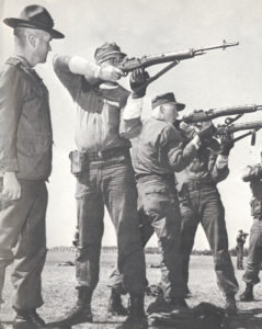A drill sergeant eyes Al Louthian as he learns the fine art of marksmanship during Marine Corps boot camp at Parris Island, South Carolina in 1966.  | Courtesy photo