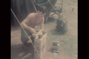 U.S. Marine Keith Burd heats up his C-Rations in this December 1967 photo. Nearby is a small Christmas tree his family sent from Wisconsin. Today, Burd is the pastor at Pilgrim Presbyterian Church in Kingsville, Maryland. | Courtesy photo