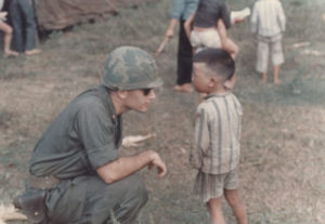 Army veteran George Mercer befriends a Vietnamese child in 1967. Mercer served in Vietnam from 1965 to 1968. | Courtesy photo