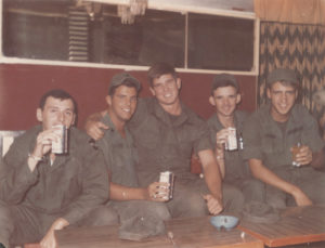 Baltimore native and U.S. Army Soldier Curt Weaver, second from left, relaxes with friends during downtime in Nha Trang. Weaver now lives in Cecil County. | Courtesy photo