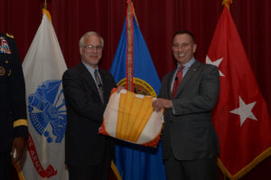 Newly appointed ECBC Senior Research Scientist for Bioengineering Dr. Peter Emanuel receives his Senior Research Scientist flag during a ceremony on APG South, Nov. 10, 2016. | U.S. Army photo