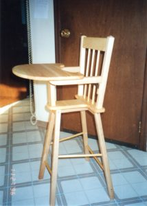 APG contractor Tom Jones built this high chair for his great-niece, Brianna, so that she would be able to sit while in a cast for a year. The cast forced her legs to an 180-degree angle to correct a displaced hip. | Courtesy photo
