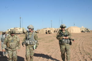 The 2nd Brigade Combat Team, 1st Armored Division brigade commander (left) and his staff discuss coalition data sharing during Army Warfighting Assessment 17.1 at Fort Bliss, Texas on Oct. 14, 2016. | U.S. Army photo