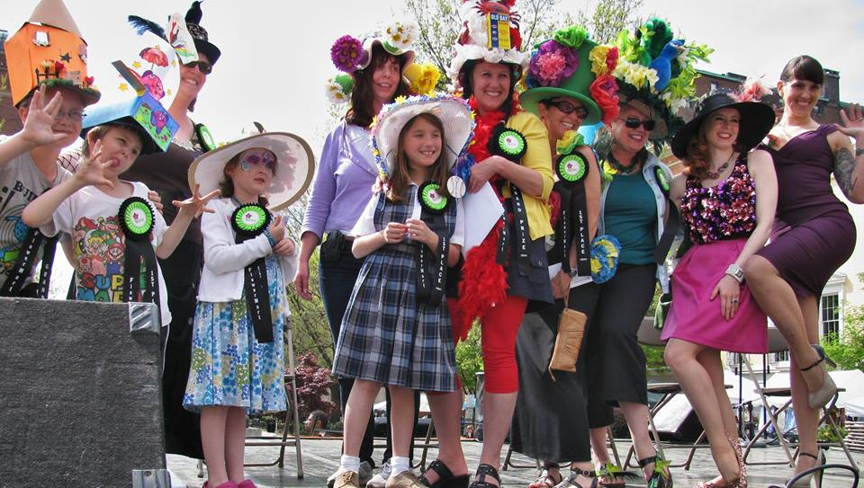 The winners of the annual Grand Hat Contest during a past Baltimore FlowerMart proudly show off their award-winning hats and prize ribbons.  Courtesy photo